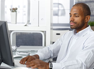 African American Business Man on Computer