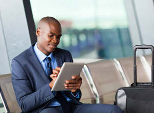 African American Business Man on Tablet at Airport