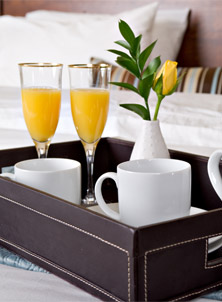 Breakfast Tray on Bed at Hotel