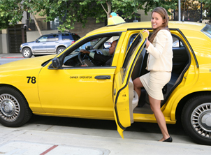 Business Woman Getting in Taxi