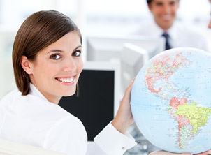 Business Woman Holding Globe