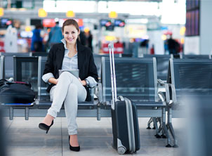 Happy Young Business Woman In-Airport