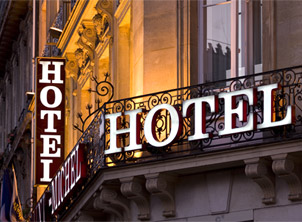 Illuminated Parisian hotel sign