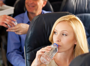 Lady Drinking Water On Airplane