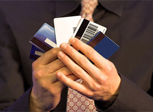 Man Holding Stack of Credit Cards