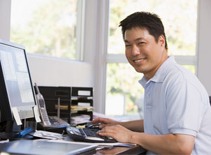 Man In Office At Computer