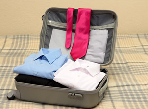Open Grey Luggage with Business Clothing