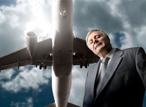 Senior Businessman Airplane Overhead