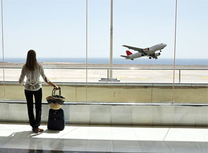 Woman Watching Plane Take Off