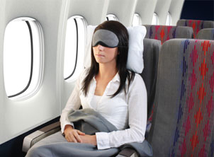 Young Woman Sleeping On Plane